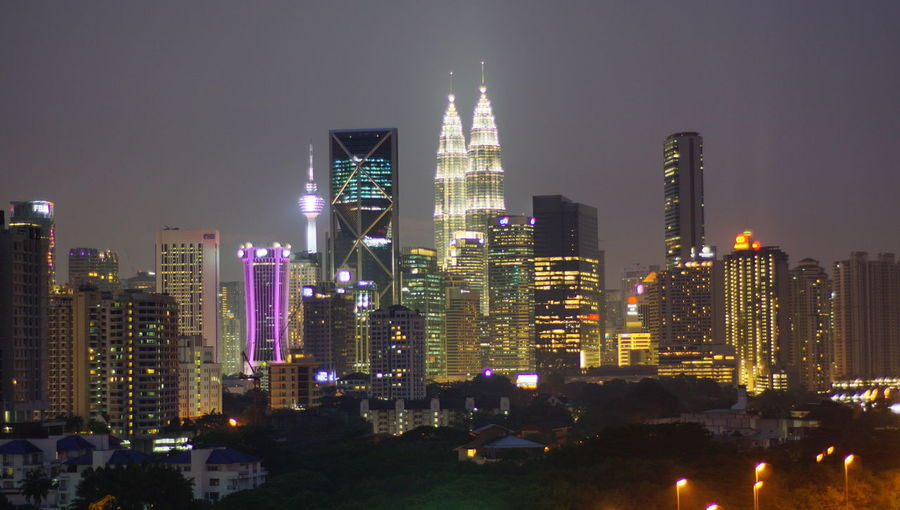 Malaysia city skyline illuminated at night. Architecture Building Building Exterior Built Structure City Cityscape Financial District  Illuminated Landscape Modern Nature Night No People Office Office Building Exterior Outdoors Sky Skyscraper Spire  Tall - High Tower Urban Skyline