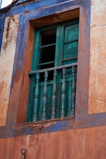 Broken Window Old House