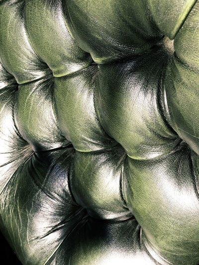 Green leather chair detail. Bristol, Rhode Island, USA. Photo by Tom Bland. Chair Chairs Close-up Decor Detail Furniture Furniture Design Green Green Color Green Leather Chair Indoors  Interior Interior Decor Interior Views IPhone IPhoneography Leather Leather Chair Old-fashioned Style Textural Texture Textured  Armchair