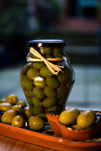 Close-up of olives in jar on table