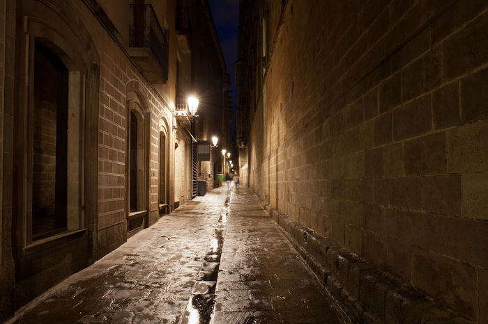 Narrow alley in the Gothic Quarter (Barri Gotic) of Barcelona at night in Catalonia, Spain After The Rain Barcelona Barri Gótic City Dark Gothic Narrow Nightphotography Old Town SPAIN After Rain Alley Ambience Architecture Atmopshere Building Dark Alley District Europe Gothic Quarter Historic Night No People Shadow Street