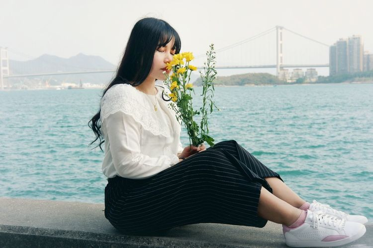 flowers #Nature  #hongkong #outfit #OOTD Sitting Women Relaxation Beautiful Woman Long Hair Black Hair Business Finance And Industry Individuality Thoughtful