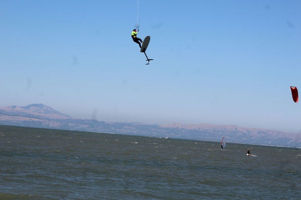 Adventure Day Extreme Sports Flying Full Length Hanging Jumping Kiteboarding Leisure Activity Lifestyles Men Mid-air Motion Nature One Person Outdoors Paragliding Real People RISK Sea Skill  Sport Vacations Vitality Water #FREIHEITBERLIN