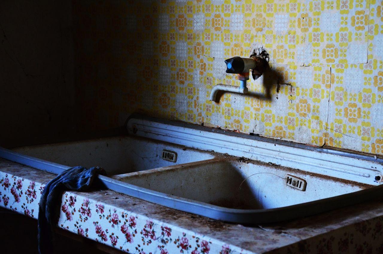 indoors, domestic room, domestic bathroom, wallpaper, abandoned, no people, bathroom, home interior, architecture, day, bathroom sink, wash bowl, mammal