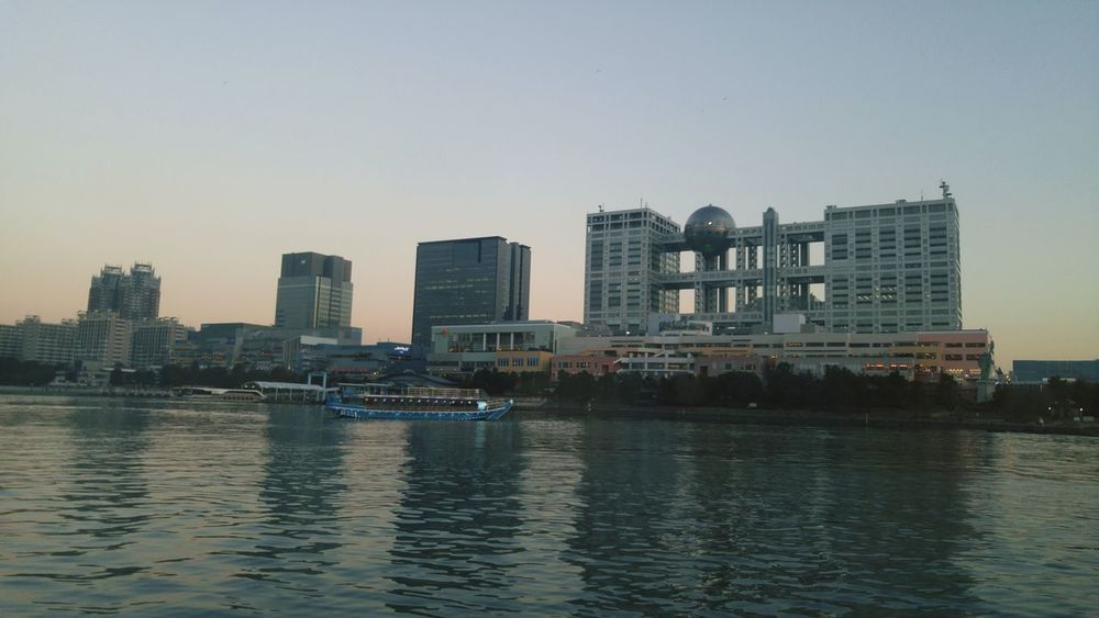 Odaiba at sunset and a houseboat House Boat Dusk Vintage Cloud - Sky Sentimental Love Date Happy Couple Family Japan Tokyo Incredible EyeEm Selects Architecture Skyscraper City Urban Skyline Building Exterior Downtown District Cityscape Built Structure Sky Travel Destinations Sunset Outdoors Day