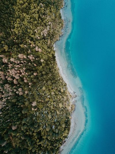 Beach Sea Water Beauty In Nature No People Sand Nature Day Scenics Tranquil Scene Blue Outdoors Wave Landscape Horizon Over Water Sky Drone  Dji DJI Mavic Pro Split Contrast Trees Green Color Blue Water Perspectives On Nature