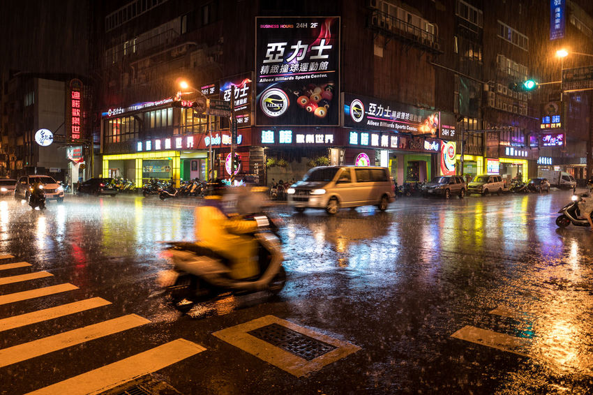 Tainan, Taiwan Architecture Blurred Motion Building Exterior Built Structure City City Life City Street Illuminated Land Vehicle Mode Of Transportation Motion Night on the move Outdoors Rain Rainy Season Road Sign Street Transportation Water Wet