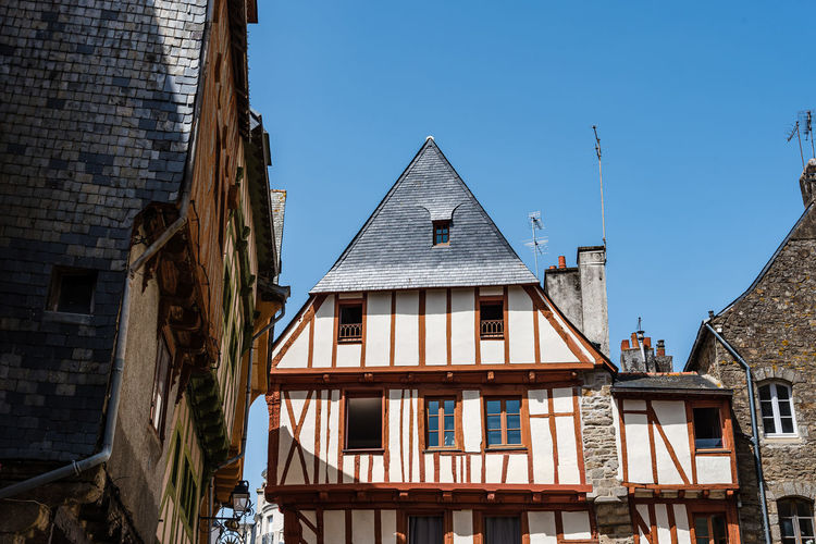 Low angle view of colorful timber-framed medieval house in historic centre of vannes, brittany