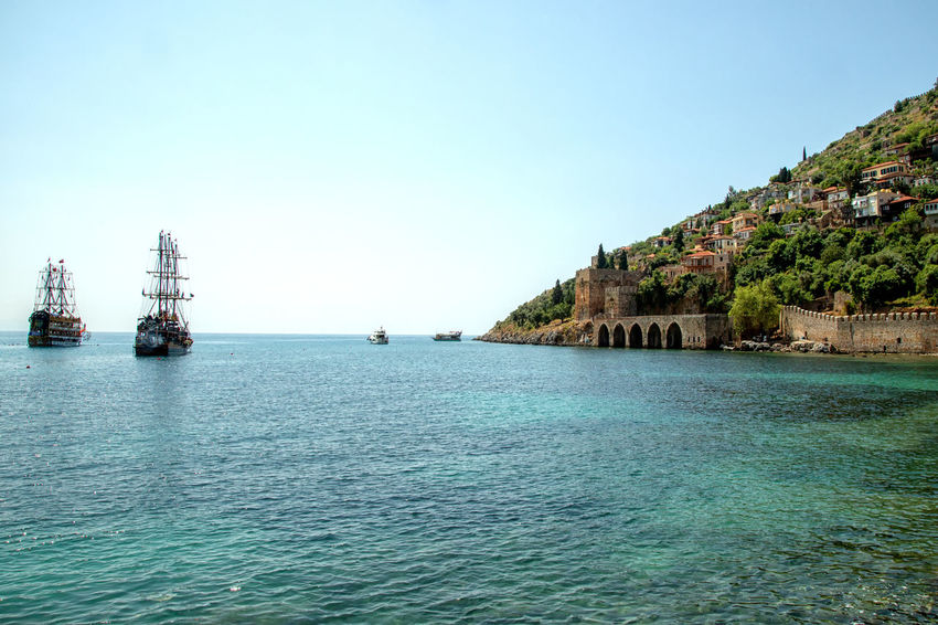 Historical Shipyard Alanya Mediterranean  Mediterranean Sea Turkey Beauty In Nature Blue Clear Sky Clear Waters Emeraldcoast Mode Of Transportation Nature Nautical Vessel Passenger Craft Pirate Ship Sailboat Scenics - Nature Sea Ship Ship Yard Sky Tranquil Scene Tranquility Transportation Water Waterfront