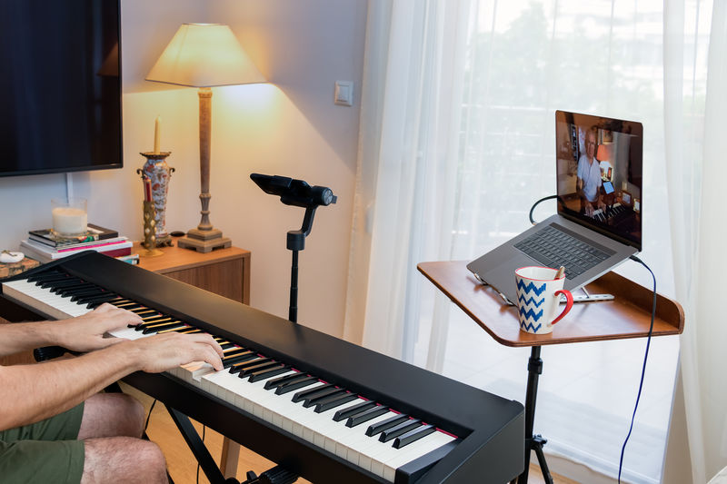 People playing piano at home