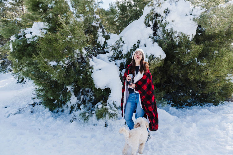 Full length of woman on snow covered landscape during winter