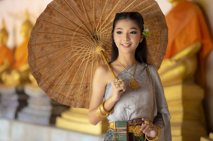 Thailand or Thai costume Asian dress Thai beautiful woman are walking in the Buddhist temple in Ayutthaya,Thailand ASIA Asian  Ayutthaya Beautiful Fashion Grace Thai Thailand Travel Beauty Buddhism Clothing Costume Courtesy Culture Cute Girl Lanna National Dress Portrait Smile Smiling Tourism Traditional Women