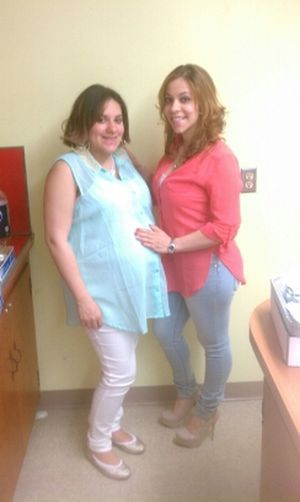 me and my sister in law at my baby shower
