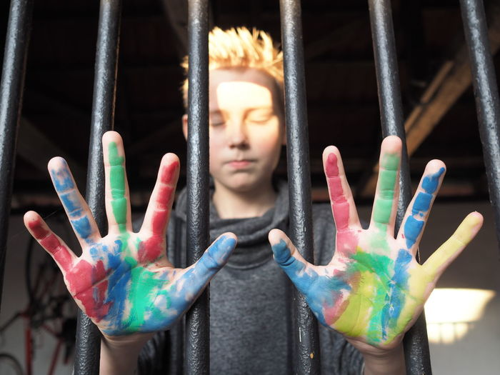 Boy Colored Hand Colorful Colors Colour Coloured Hands Colourful Colours Contrast Jail Prison Regret Sadness Teen Young Prisoner Enjoying Life Enjoy The Moment Golden Moment Moments Best Shots EyeEm Light And Shadow Light Young Prisoner Lifestyles