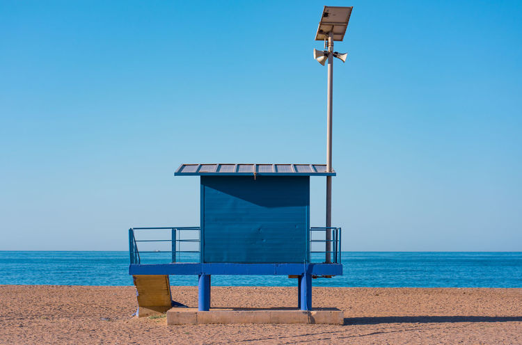 Vintage blue baywatch tower against deep blue ocean and clear sky. Baywatch Beach Life Solar Surf Paradise Surfers Paradise Watch Tower Baywatch Tower Beach Beachphotography Blue Clear Sky Day Land Nature No People Ocean Outdoors Sky Speaker Box Surfers Home Tower