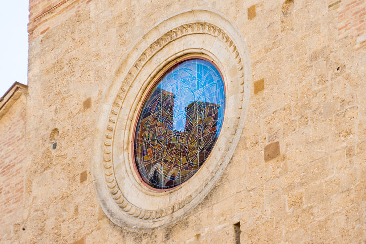 Reflection San Gimignano Tuscany Architecture Belief Building Building Exterior Built Structure Circle Day History Italy Low Angle View Nature No People Outdoors Place Of Worship Religion Stone Wall The Past Wall Wall - Building Feature Window