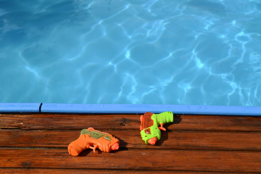 Summer Commercial Advertising Asvertising Advertisement Pool Water Wet Water Gun Water Guns The Essence Of Summer Playing Kids Playing Kids Cool Pool Time Summertime People Of The Oceans Two Is Better Than One