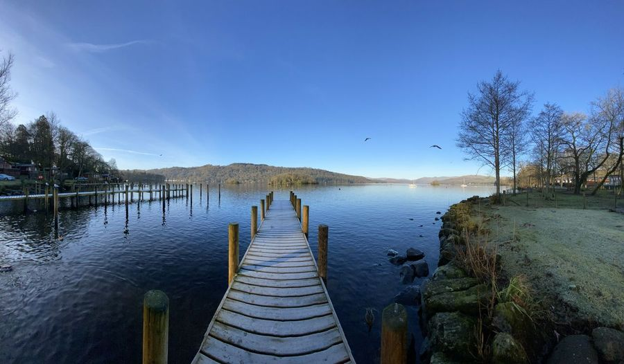 Panoramic view of pier on lake against sky