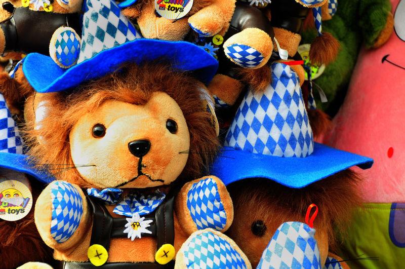München, Oktoberfest Bavarian Lion Close-up Lion With Hat Munich Munich Octoberfest Munich Oktoberfest Stuffed Toy The Bavarian Art Of Comfort