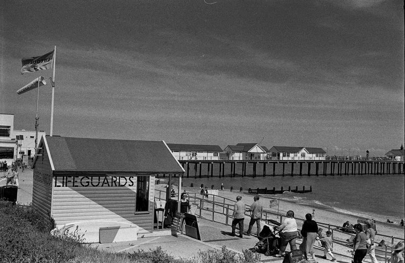 Lifeguard Post at Southwold Beach Arid Climate City Life Clear Sky Community Copy Space Day Desert Human Settlement Life Guard Post Outdoors Pier Prom Promenade Walking People Sun Shine Remote Residential District Sand Sand Dune The British At The Seaside On Holiday Kids Children Two 2 Girls On Jetty Watch Dingy Deep In Thought Seaside Jetty Water Wake Dingy Orange Sand Coastline Suffolk Horizon Documentary Reportage Photography Taking Shots Colour Color Dresses From My Point Of  The British On Holiday By The Seaside Waves White Crest Foam Sea Ocean Beach Sand Bathing Trunks Crocks Thinking Deep Thoughts Contemplation Man Male White Pale Lonly Looking Figure Sad Sadness Documentary Reportage Photography Photograph Photographer Col Tranquil Scene Tranquility Urban Water Wood Wood - Material