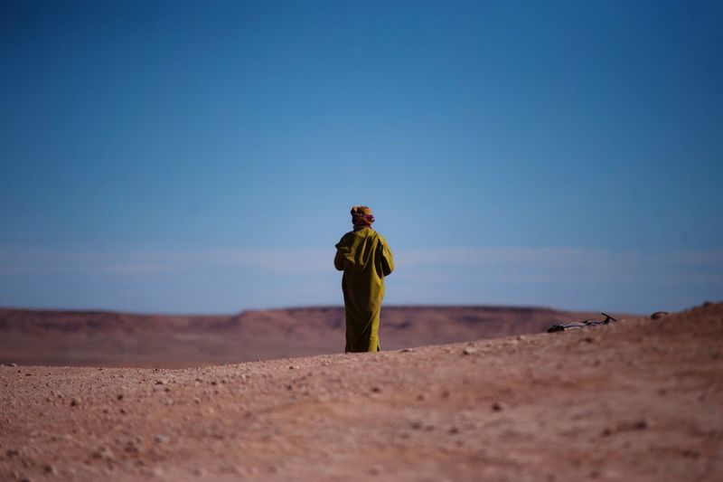 Erg Chebbi. Desert Sand Rear View Clear Sky Sand Dune Landscape Tranquil Scene Outdoors Nature Beauty In Nature Full Length Berber  Berberstyle Merzouga Morocco MoroccoTrip Desert Beauty Sahara Desert Africa African Man Traditional Clothing