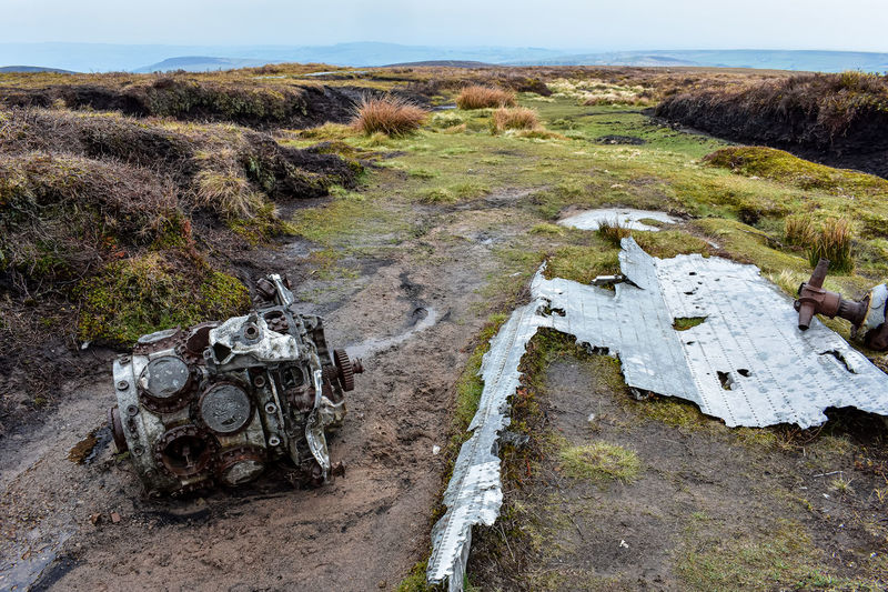 High angle view of abandoned car on field