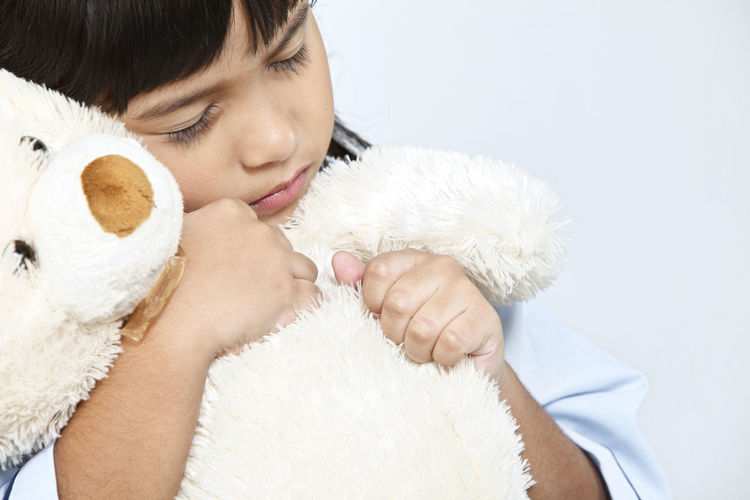 malaysia malay girl with pyjamas holding teddy bear Asian  Eyes Closed  Females Hugging Innocence Bangs Black Hair Child Childhood Cute Elementary Age Girl Headshot Indoors  Malay Malaysia Offspring One Person Pyjamas Softness Studio Shot Stuffed Toy Teddy Bear White Background Women