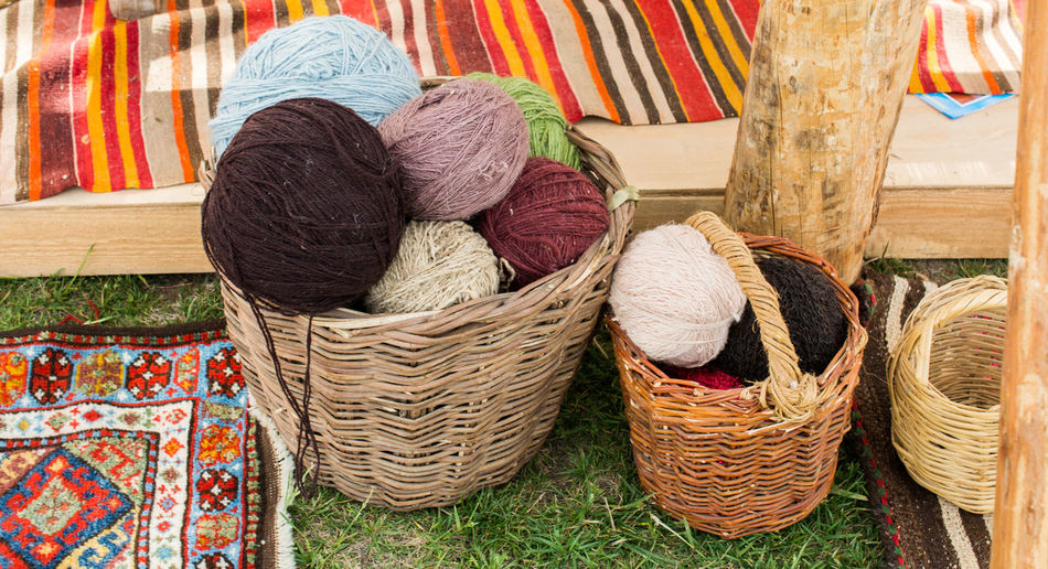 High angle view of multi colored wicker basket for sale at market stall