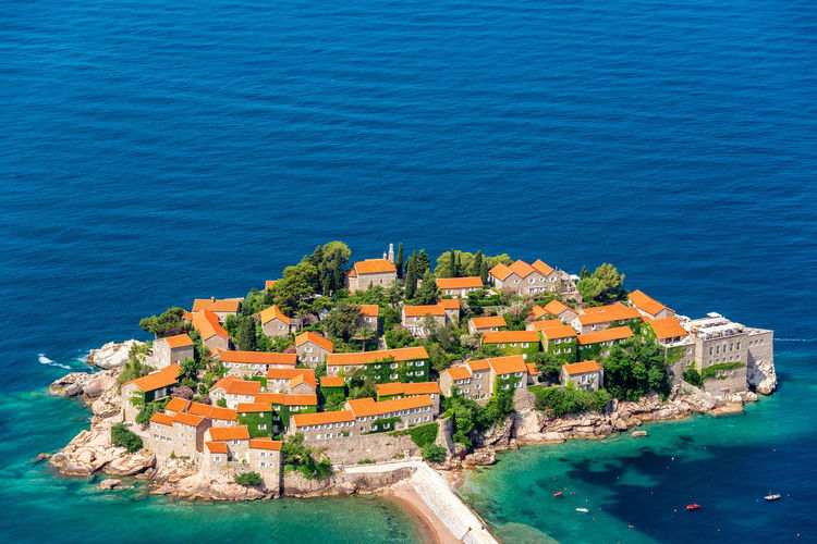 Aerial view of picturesque Sveti Stefan in Montenegro No People Montenegro Europe Travel Tourism Destination Balkan Balkans Eastern Europe Architecture Medieval Historic Sveti Stefan Sea Island Resort Water High Angle View Aerial View Blue Nature Adriatic Sea Scenics - Nature Travel Destinations Outdoors