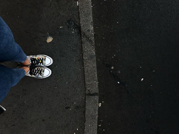 Street Converseallstar Converse Street Life Streetphotography Street Foot Legs Low Section Human Leg Shoe One Person Human Body Part Body Part Real People Lifestyles Standing City Human Limb Limb Road Street High Angle View Directly Above Day Leisure Activity Asphalt Human Foot