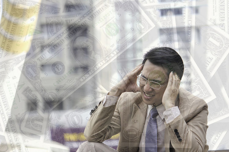 Double Exposure Image Of Businessman With Headache And Paper Currency