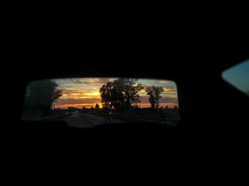 Breathing Space - Just Breath - Wonderful Day Wonderful Sunset 🌇 Car Illuminated Sunset No People Night Outdoors Sky Urban Scene Huaweip9photos Shapes , Lines , Forms & Composition HuaweiP9Photography Huaweiphotography Journey Car Interior Clouds Sunset Silhouettes Sunset_collection Sunsetlover