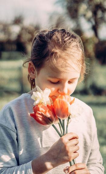 Girl holding flower