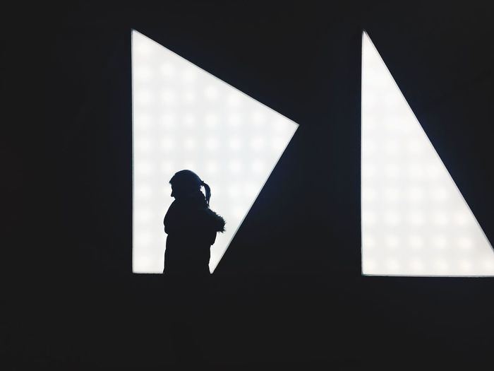 Low angle view of silhouette person against sky