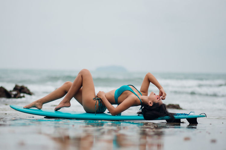 Water Young Adult Clothing Sea Swimwear Bikini Full Length Lying Down Lifestyles Leisure Activity Young Women One Person Relaxation Adult Day Nature Beauty Beautiful Woman Horizon Over Water Outdoors Hairstyle