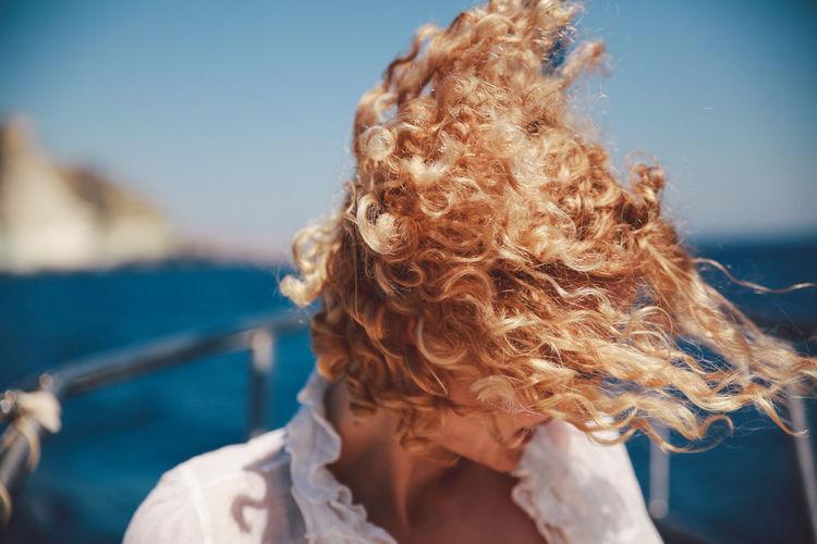 Portrait of woman in water against sky