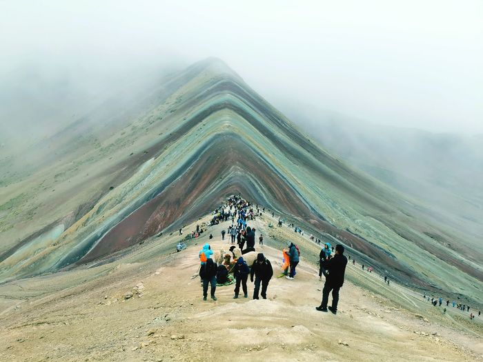 People walking on mountain road