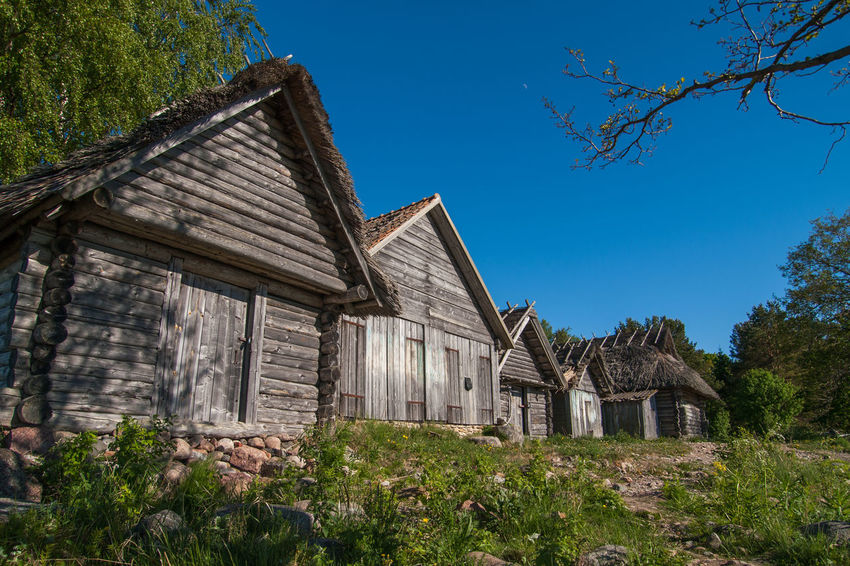 Old boathouses in Altja, Lahemaa, Estonia Architecture Blue Boathouses Built Structure Day Landscape Nature No People Outdoors Scenics Sky Tourism Travel Travel Destinations Tree Vacations Weathered Wood
