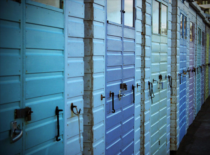 Architecture Beach Beach Huts Blue Day English Holiday Huts In A Row Indoors  Locker Locker Room No People Sand Seaside