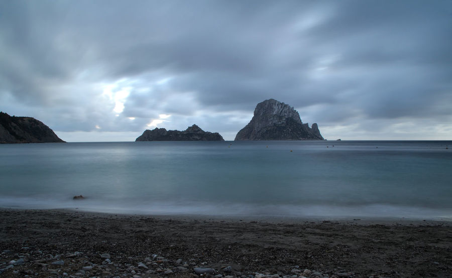 Landscape of Cala d'Hort beach in Ibiza, Spain Balearic Islands Beach Cala Cala D'Hort Horizon Over Water Ibiza Illes Balears Island Islas Baleares Landscape Long Exposure Mediterranean  Nature No People Ocean Outdoors Rock Scenics Sea Sky Stone Sunset Travel Water Waves