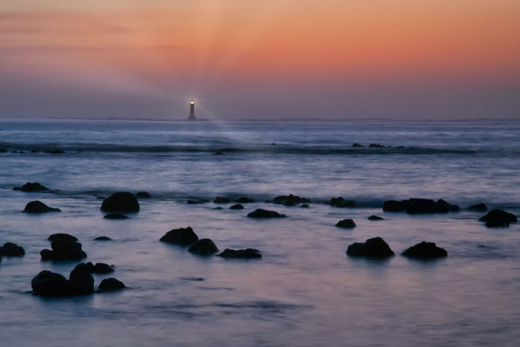 sunset and low perspective sea scape at the Almadies Sea Water Sky Scenics - Nature Sunset Rock Beauty In Nature Solid Horizon Over Water Rock - Object Horizon Land Tranquil Scene Beach Tranquility Idyllic Orange Color Motion Nature No People