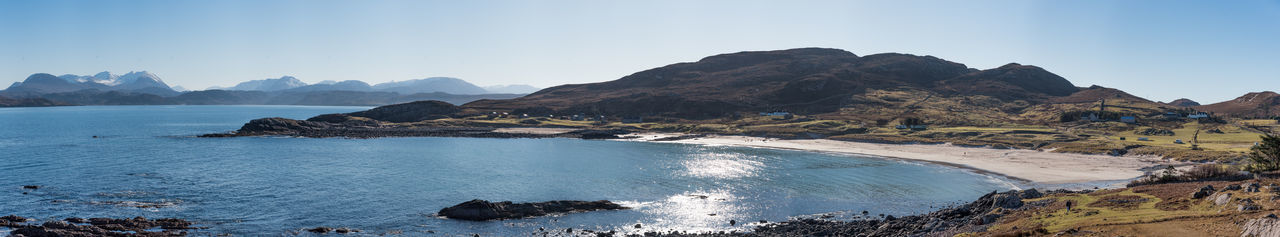 Scotland 💕 Beach Beauty In Nature Blue Clear Sky Day Hill Top View Of Mellon Udrigle Beach Holiday Destination Landscape Mountain Nature No People Outdoors Panoramic Photo Merge Photography Rock - Object Scenics Sea Sky Travel Destinations Tree Water