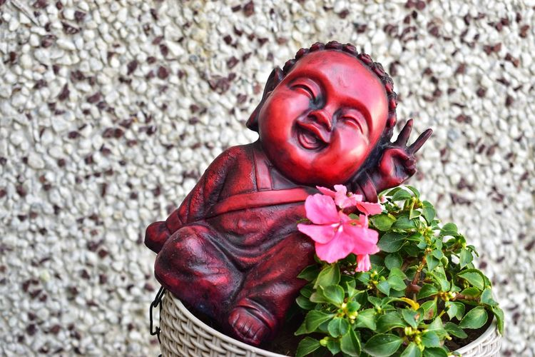 A HAPPY BUDDHA Buddha Buddha Statue Buddha Image Buddha Head Smiling Buddha Smiling Smiling Face Victory Victory Sign Flower Head Flower Warm Clothing Portrait Red Bouquet Rose - Flower Petal Pink Color Close-up Wearing Flowers Wreath Rose Petals Bunch Of Flowers Blooming Flower Market Flower Arrangement Zinnia  Florist