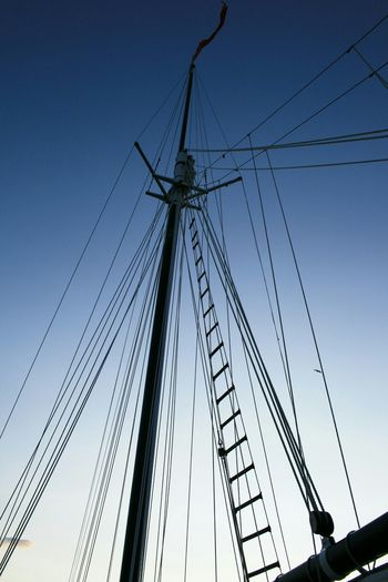 Low Angle View Of Sailboat Masts Against Clear Sky