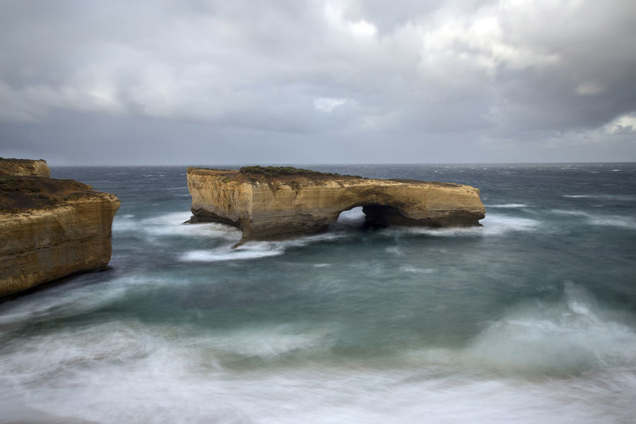 London Bridge at stormy Ocean Australia Dramatic Sky Great Ocean Road Storm Twelve Apostles Beauty In Nature Cloud - Sky Day Horizon Over Water Idyllic Long Exposure Natural Arch Natural Bridge  Nature No People Outdoors Rock - Object Rock Formation Scenics Sea Sky Water Waterfront Wave Waves