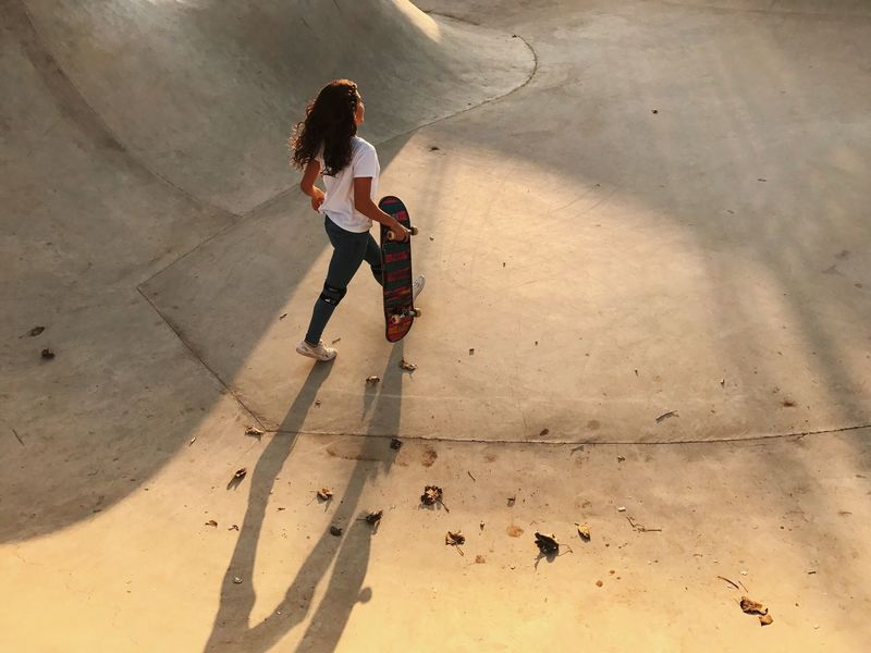 Two People Full Length High Angle View Day Young Women Young Adult Shadow Togetherness Standing Women Outdoors Friendship Skateboard Park People Adult Adults Only The Street Photographer - 2017 EyeEm Awards מייסקייט IPhone7Plus מייאייפון7 Shotoniphone7plus Breathing Space Paint The Town Yellow