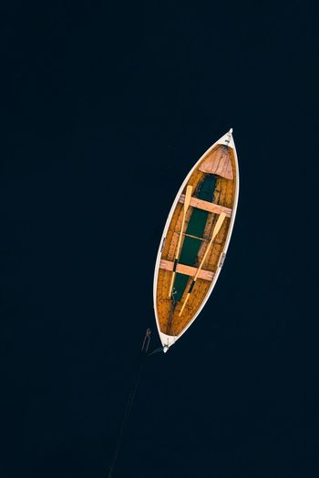 Directly above shot of abandoned boat on calm sea