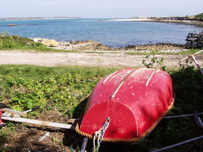 Beach Boat Day Grass Horizon Over Water Nautical Vessel No People Outdoors Red Scenics Scilly Isles Sea Tranquil Scene Tranquility Upturned Boat Water