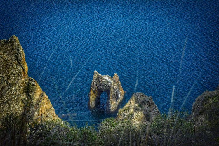 High angle view of rocks on sea