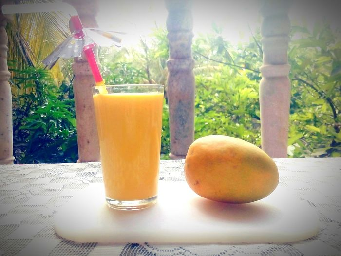 Morning breakfast Mango Smoothie Summer Drink Drinking Glass Drinking Straw Freshness Outdoors Nature No People Tropical Drink Close-up Yellow Color Fruit Photography Fruits Lover Mangoes♥ Mango Season Yummy ♥ Fruitlicious Summer2017🌞 Move On Eyeem EyeEmNewHere PhonePhotography Eyeem Photography Goa India BYOPaper!